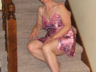 On the stairs and in her pink lingerie...