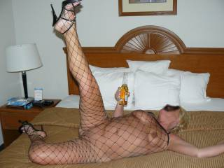 sexy modeling her body stocking and heels for her lover