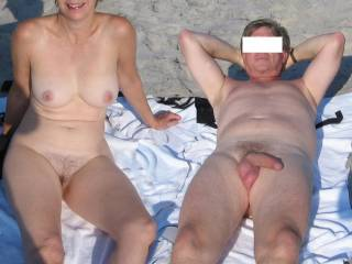 Nothing better than a naked day on the beach, catching rays, sipping vino, watching cocks, pussys and tits walk by, - then heading home with a dripping wet pussy and a rock-hard cock!