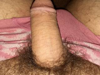 Soft cock resting on pink panties