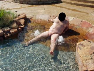 Hubby in our pool, just like I like to keep him...NUDE!  Wanna get wet with him?