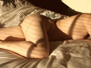 Love the shadow from the blinds across her body.