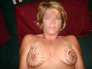 I'd love to use my cum and cover those beautiful breasts! How about a target and the nipples are bullseyes? Or make the nipples owls eyes like a hooters girl outfit? Would love to see if you do use my thoughts!