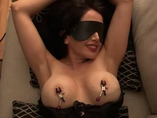Tied up, blindfolded and with nipple clamps