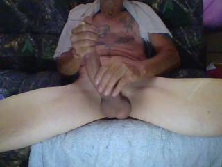 stroking my hard cock and showing it to you