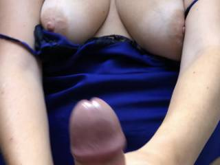 Handjob aiming over her big tits and face