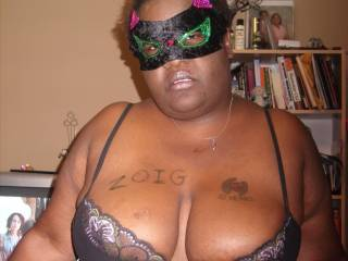 This is a picture of my beautiful wife and her beautiful tits. See Zoig on the right breast? She is wearing a mask because she is really shy.
