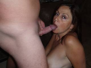 Al finally releases his load on Candi Annie - more than she can swallow!  Cum drips out her mouth and her face is covered as the warm jizz drips off her chin and onto her beautiful tits!