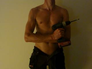 Sexy man with a power drill.  Yeah.. I bet you are handy.