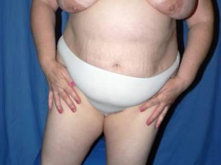 Topless wearing white panties.......