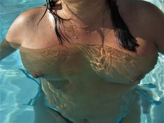 Topless in neighbor\'s pool.  Super hot weather today (96).