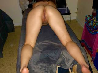 a beautiful 23y/o on my massage table..she has cum a few times and now she's getting on the table...ready for what I want to do and will do so much..because I do things no one had done before.  How beautiful is this sight??!!