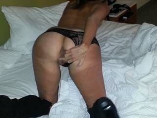 My sexy wife in her black boots. I want to fuck her right there! She is getting her pussy ready for a spit roast!