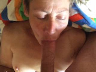 The wife working my cock with a cum shower on her face at end