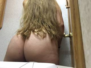 Husband took this picture without me knowing it, then he shown it to me later.....I kinda like how my hair drapes over the curve of my butt.  :  )