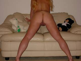 I love that pose Cyndi!  I'd like to lick your from behind and then ride that hot ass while giving those pigtails a pull!