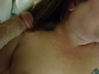 Slutty wife is getting ready to receive a load of hot cum on her breasts!