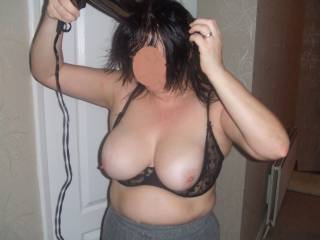 Her well used saggy tits spilling out of her 1/2 cup bra, the dirty whore likes them on show