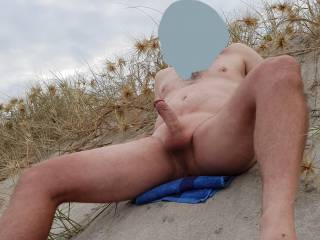 Very horny at the nude beach. I was getting very hard for the camera.