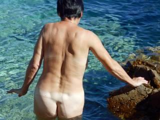 Wife taking a dip in the ocean