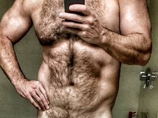 Very sexy man.  Would you let me run my fingers through that chest hair?