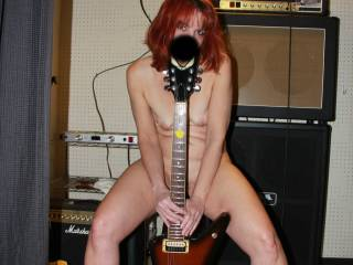 Dedicated to Wannaseemore. A funny little story here. We were painting at a customers house and most often we are alone. There was this Guitar setup in the basement and it looked like it needed some showing off, so I did. Who wants to CUM and play with m