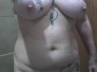 In the restroom and because her top was off Sally decided that full nudity was in order!