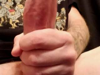Rubbing cock with precum dripping out