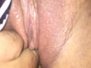 Fingering her tight pussy