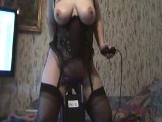 beautiful woman, and she looks sexy as hell riding her toy in those black stockings!!!