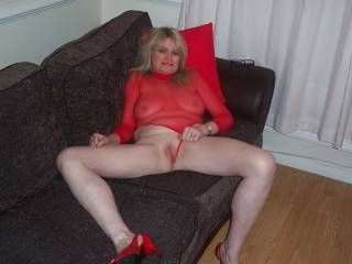 Beautiful Lady in red mmmm and what a sexy body. Would love to be licking you hot sweet pussy