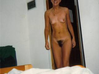 a perfect lady, lovely smile, beautiful breasts and the most perfect dark pussy triangle-please don't trim it, your pubes are fantastic and so sensuous to the touch
