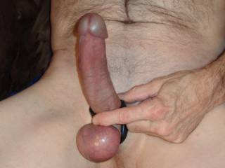 Just your basic hard, shaved cock wearing a cock ring.