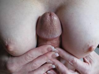 massaging my hard cock between her sweet tits