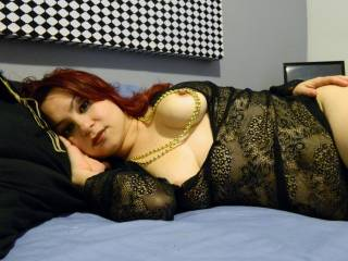 Love the beautiful breasts and the creamy white skin, topped off with red hair! Hot just plain HOT! Keep the photos cumming!