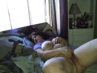 Wife laying on the bed getting her self off