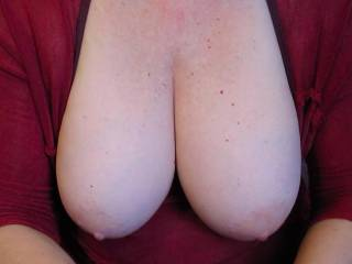 You gotta love the shape of her breasts. And the lovely skin. It would drive anybody crazy if you saw her pop her tits out like this