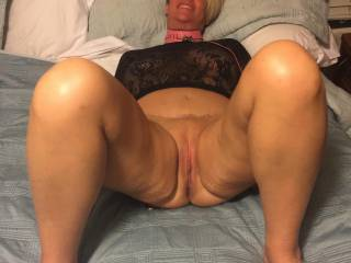 Would you like to tribute this hot MILF.  She is all spread out ready for a good fucking.