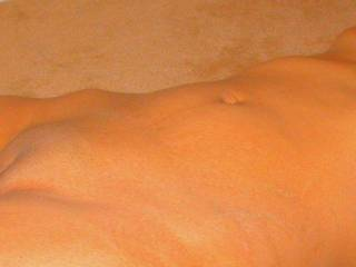 I love her body...her bald pussy, her erect nipples and her soft full lips.