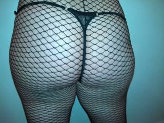 Looking at your beautiful ass with this sexy fishnet makes my cock as hard as it can be!