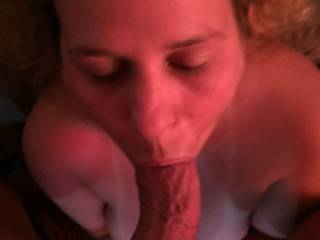 Neighbors wife with my dick in her mouth.  She doesn't want to fuck because she feels like that's cheating,  She said a blowjob wasn't really cheating.