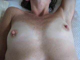 My wife\'s sexy small tits. I am lucky enough to suck on them whenever possible!