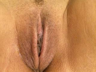 Her sweet little pussy as hairy as she let it get. :)