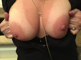 Teasing me with her beautiful tits before going out with friends for the night.