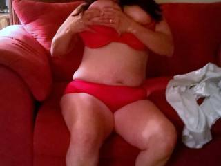 My wife looking good in some red undies licking her tits with no effort at all.