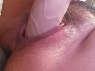 Filling my pussy, taking the edge off. Horny as fuuuuuuck. I need fucked hard