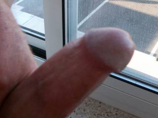 Jacking off in hotel room window.  Wish she would look up and watch me jack my dick off on the window!
