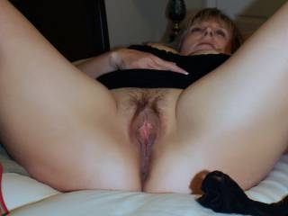 Lovely lady, and such a hot mature pussy. Would love to see a hot load of man juice dripping out of it. May I offer to assist?