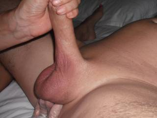 Playing with Hubby\'s lovely smooth shaven cut cock, whilst stimulating his prostate.