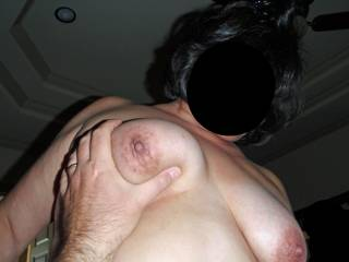 Hubby\'s got a grip on my tit, while off camera I am stroking his cock...I win!